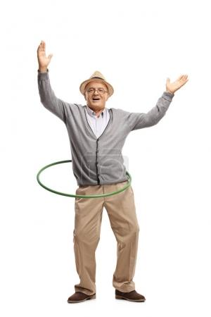 Photo for Full length portrait of a cheerful mature man with a hula hoop isolated on white background - Royalty Free Image