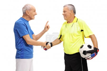 Soccer player and a goalkeeper shaking hands