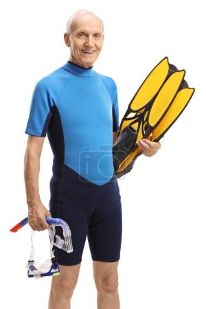 Photo for Elderly man in a wetsuit with snorkeling equipment isolated on white background - Royalty Free Image