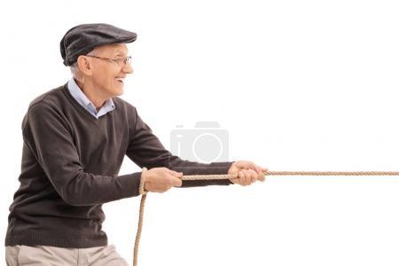 Senior pulling a rope