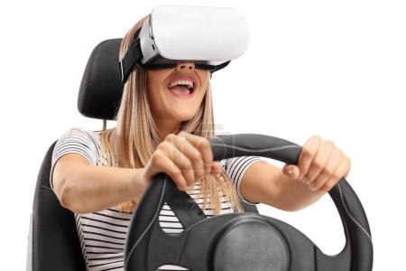 woman using a VR headset and driving