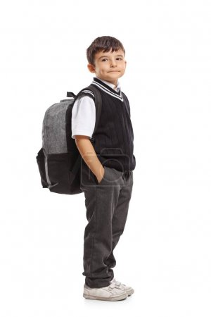 Small schoolboy with a backpack