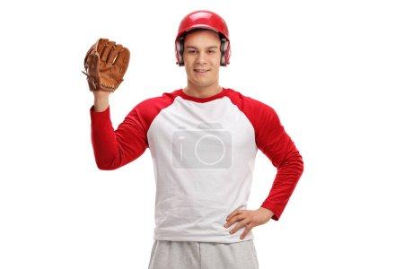 Foto de Jugador de béisbol con un guante aislado sobre fondo blanco - Imagen libre de derechos