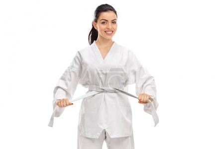woman dressed in a kimono tying a belt