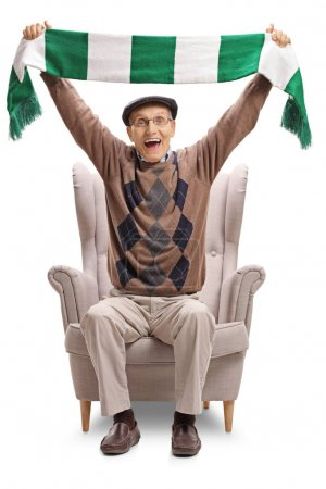 Overjoyed senior holding a scarf in an armchair