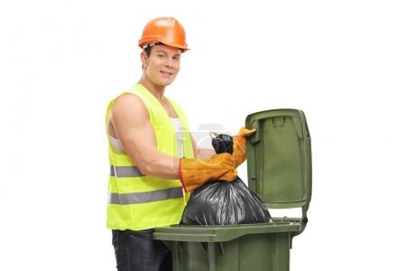 Waste collector emptying a garbage bin