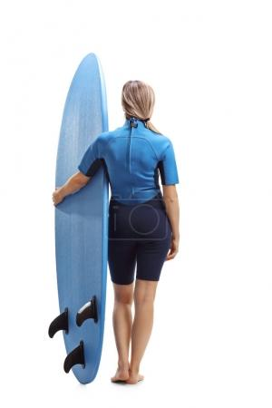 Female surfer with a surfboard