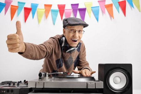 Senior playing music on turntable and making thumb up sign