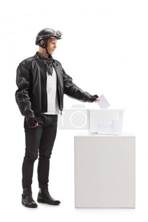 Biker casting a vote into a ballot box