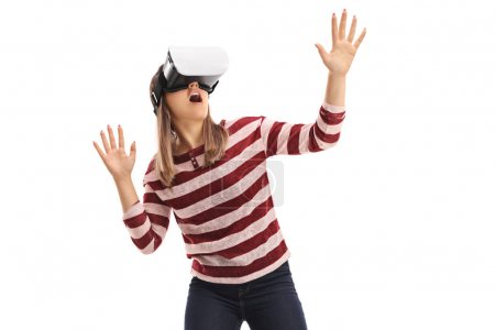 Photo for Girl experiencing virtual reality with a VR headset isolated on white background - Royalty Free Image
