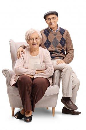 Senior couple sitting in an armchair