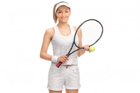 Female tennis player with a ball and a racquet