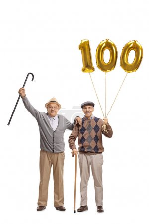 Cheerful seniors with a number hundred balloons
