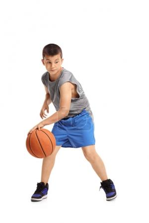 Boy dribbling with a basketball