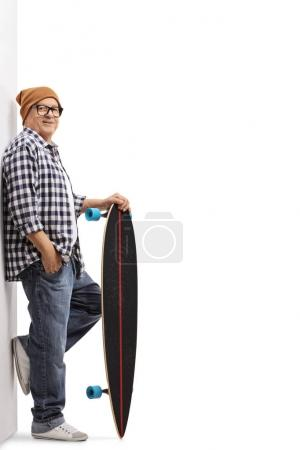 Old hipster with a longboard