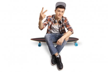 hipster sitting on a longboard and making a peace sign