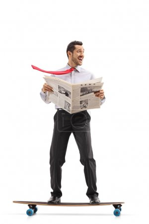 Businessman with a newspaper riding a longboard