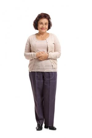 Photo for Full length portrait of an elderly woman looking at the camera and smiling isolated on white background - Royalty Free Image