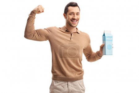 man holding a milk carton and flexing his biceps