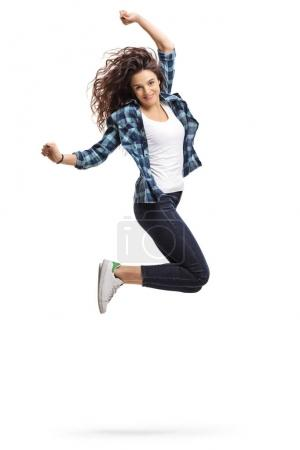 Overjoyed girl jumping and gesturing happiness