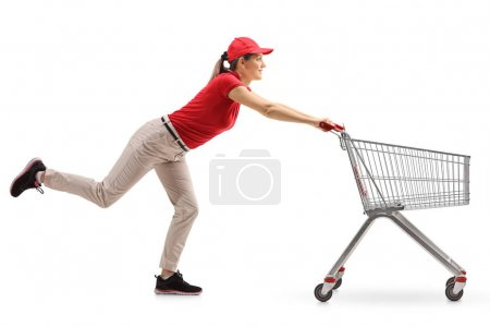 Delivery girl pushing an shopping cart