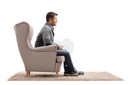 Photo for Man sitting in an armchair isolated on white background - Royalty Free Image