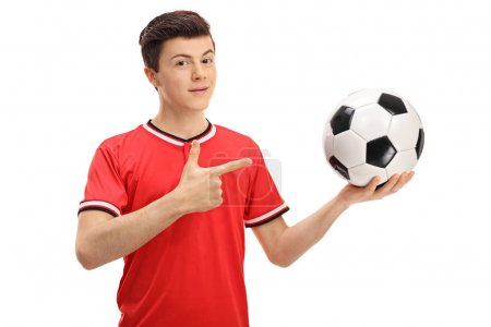 soccer player holding a football and pointing