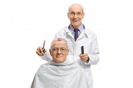 Barber preparing to give a haircut to a mature man isolated on white background