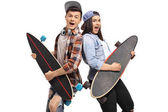 Joyful teenagers pretending to play guitar on longboards isolated on white background