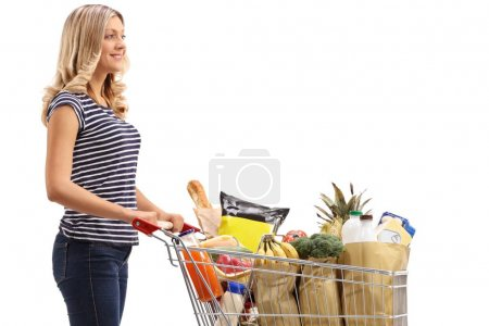 woman with a shopping cart full of groceries
