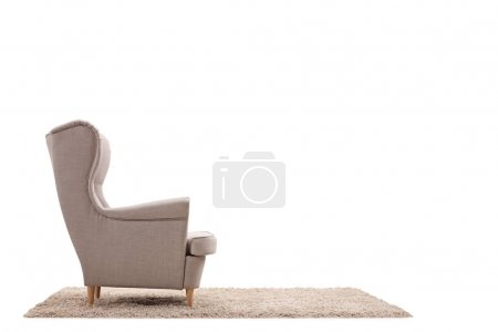 Armchair on a carpet isolated on white background
