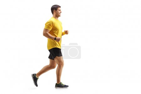 Full length profile shot of a young man running isolated on white background