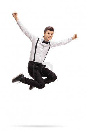 Formally dressed teenage boy jumping and gesturing happiness isolated on white background