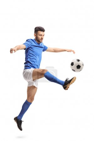 Soccer player jumping and kicking a football isolated on white background