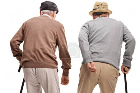 Photo for Rear view shot of two elderly men with canes isolated on white background - Royalty Free Image