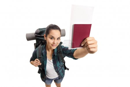 Photo for Female teenage tourist with a passport isolated on white background - Royalty Free Image
