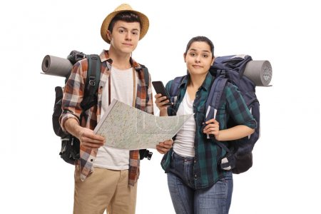 Lost teenage tourists with a map isolated on white background