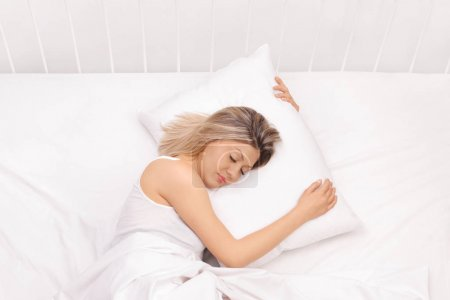 Photo for Woman sleeping in bed - Royalty Free Image