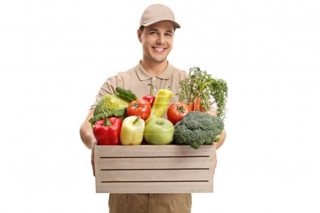 Delivery guy giving a crate filled with groceries isolated on white background