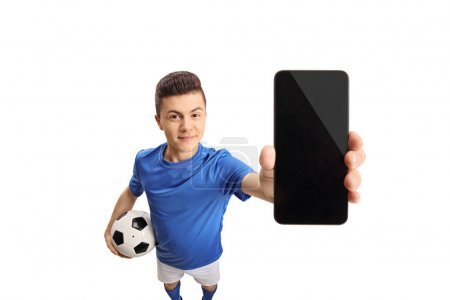 Teenage soccer player showing a phone isolated on white background
