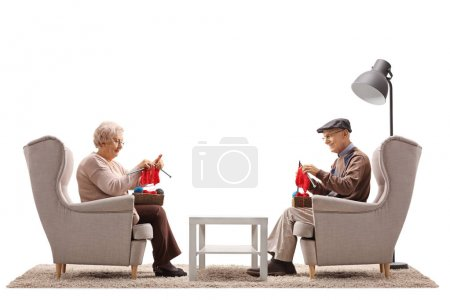 Seniors sitting in armchairs and knitting isolated on white background