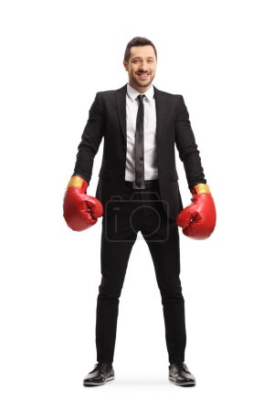 Photo for Full length portrait of a businessman wearing boxing gloves and smiling at the camera isolated on white background - Royalty Free Image