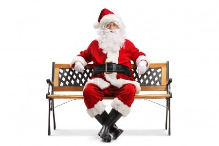 Photo for Full length portrait of Santa Claus resting on a bench isolated on white background - Royalty Free Image