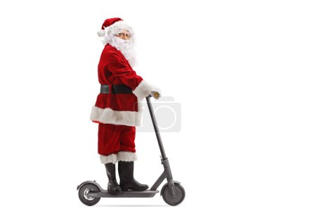 Photo for Full length shot of Santa Claus on an electric scooter isolated on white background - Royalty Free Image