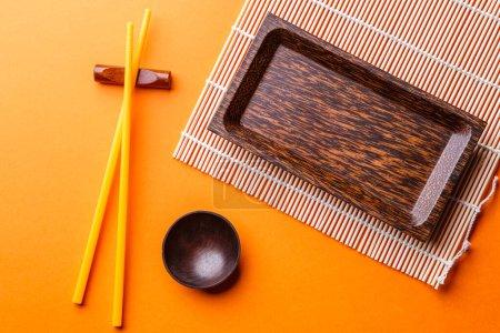 Photo for Photo of set of dishes for sushi on orange background - Royalty Free Image