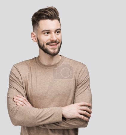Handsome smiling young man isolated on gray background closeup portrait. Laughing joyful cheerful men studio shot