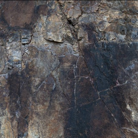 Fragment of granite rocks with large cracks