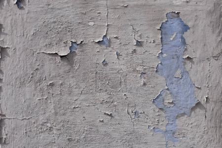 Blue painted wall with collapsed plaster