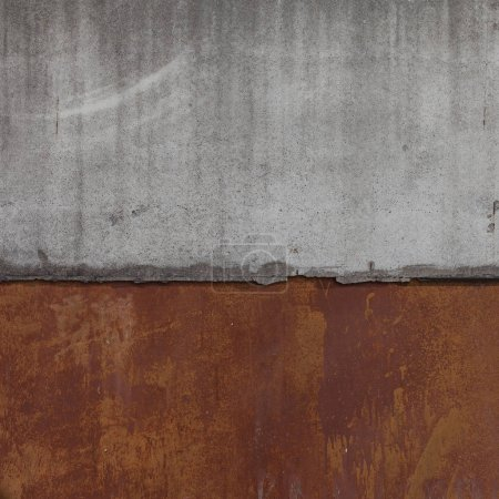 Joint of concrete slab with rusty wall