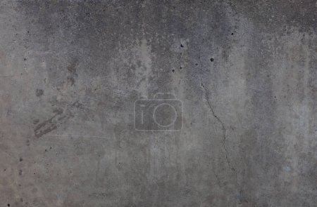 gray concrete wall with holes